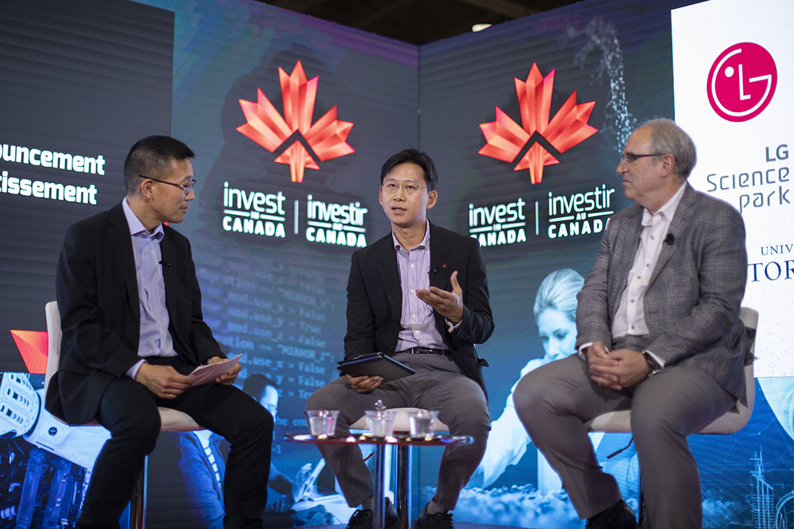 Chris Yip, U of T's associate vice-president of international partnerships, on stage at the Collision conference with LG representatives