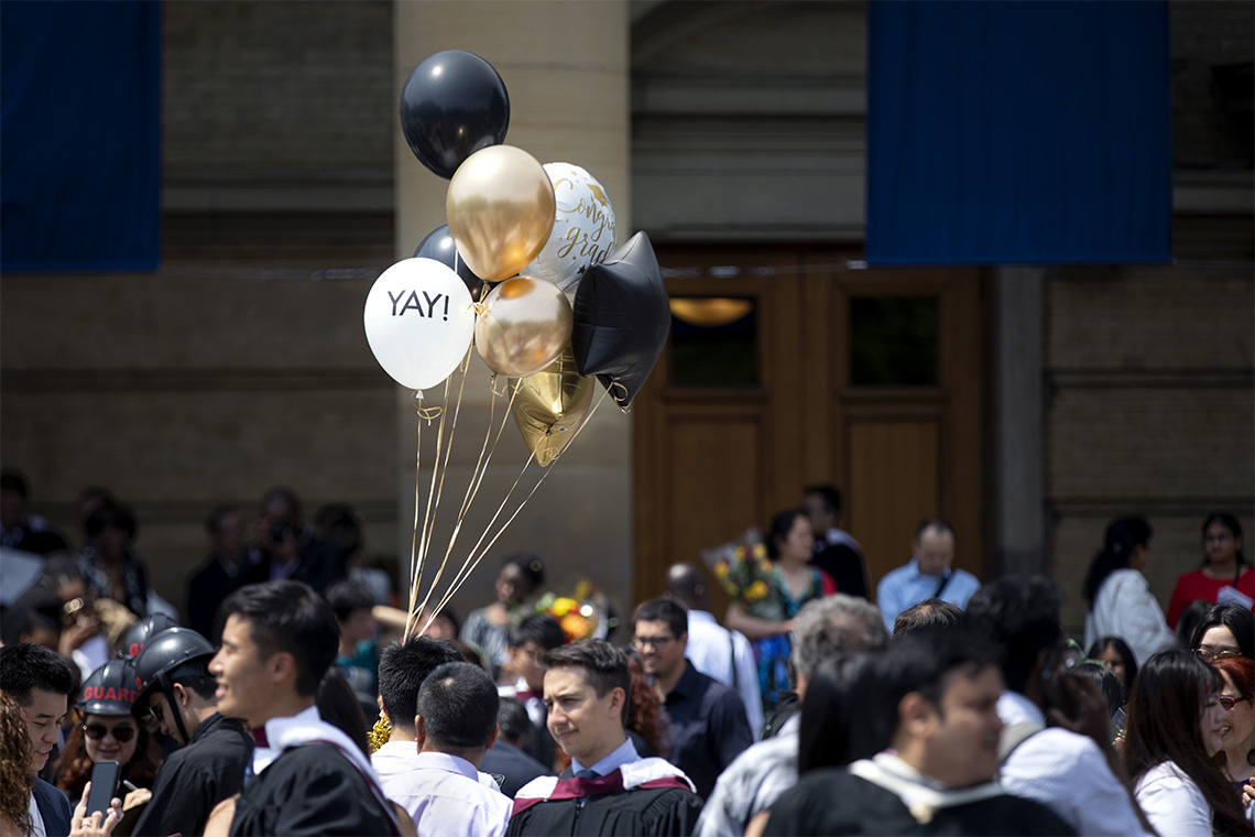 Balloon with the word Yay, seen in front of convocation hall