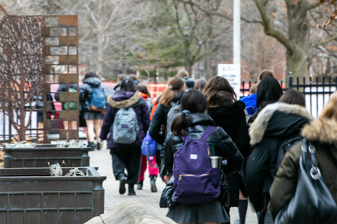 Students walking through U of T's St. George campus