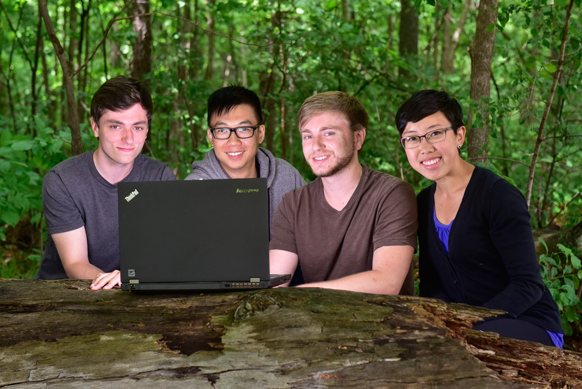 photo of the students with laptop in park