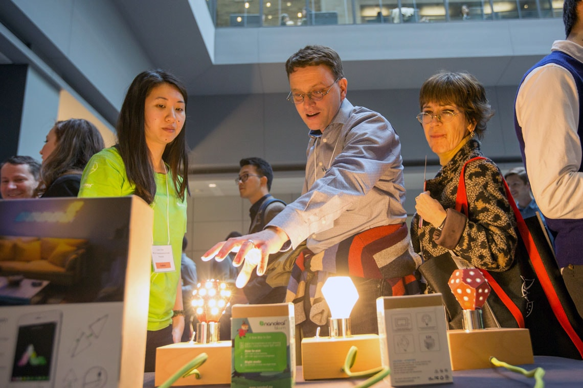 photo of conference attendees checking out Nanoleaf display