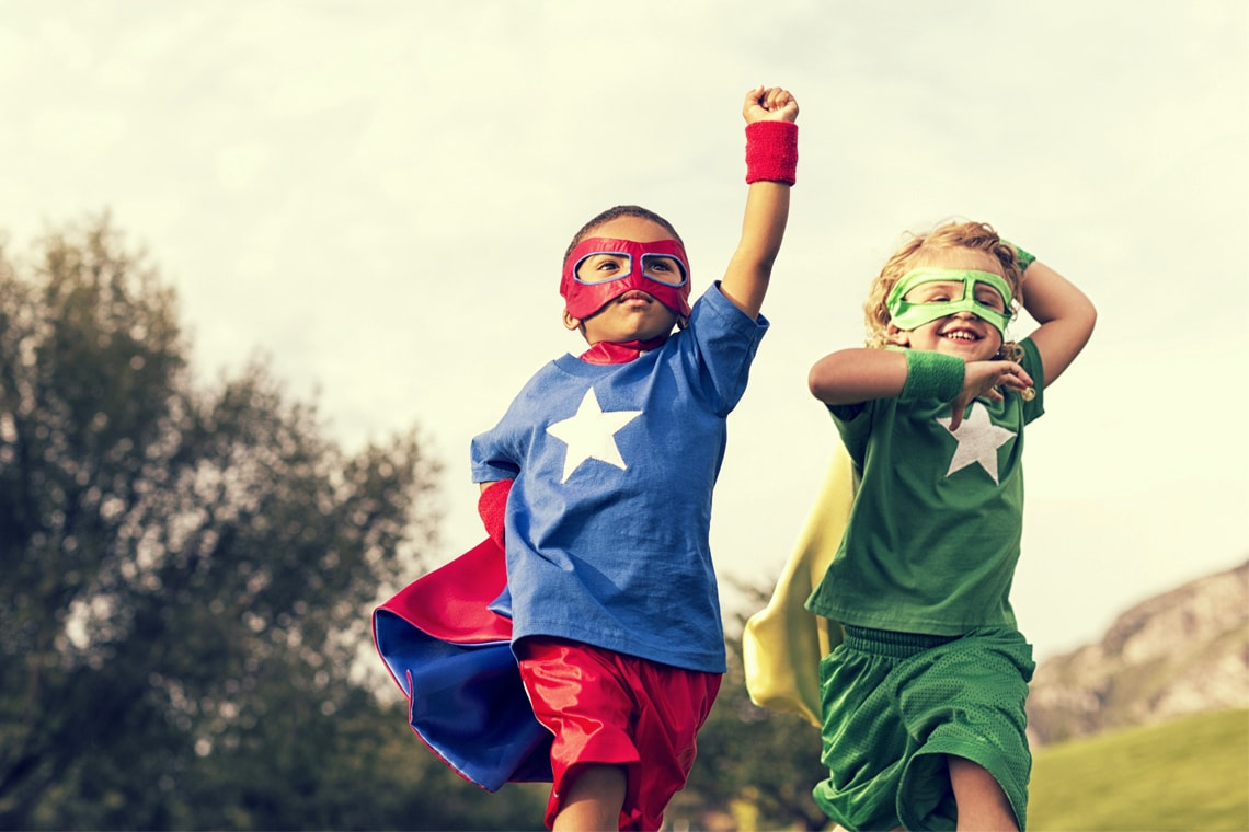 Photo of two children dressed as superheroes