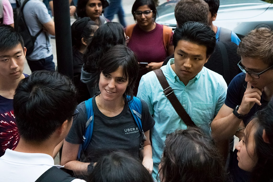 photo of Raquel Urtasun surrounded by students
