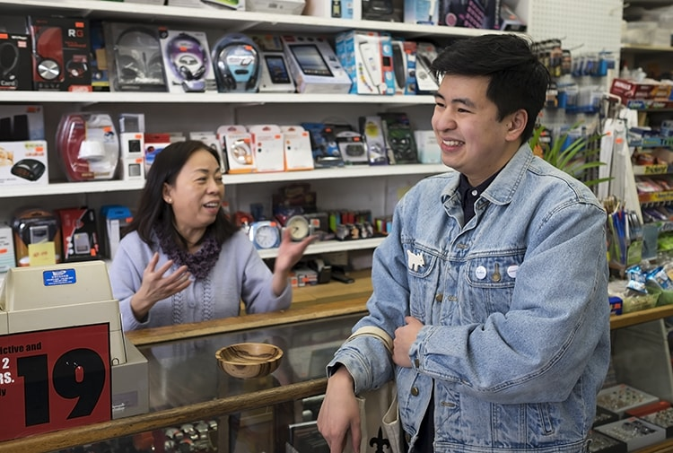 Picture of Phat Le and his mom in their family's convenience store on Queen St W