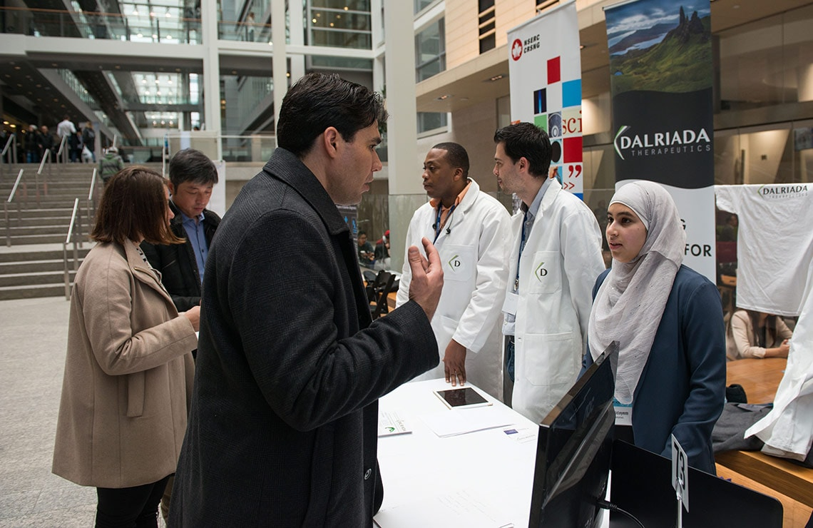 Photo of students at Startup Showcase booth