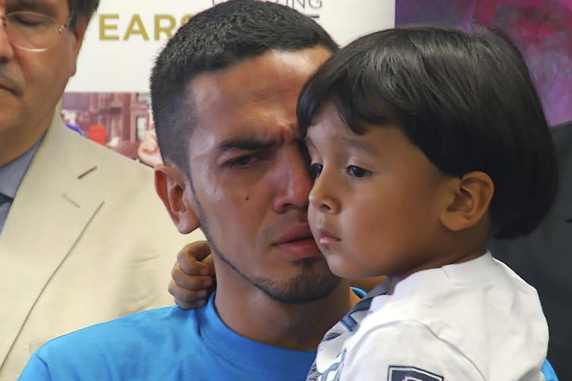 Photo of father and son reunited in U.S.