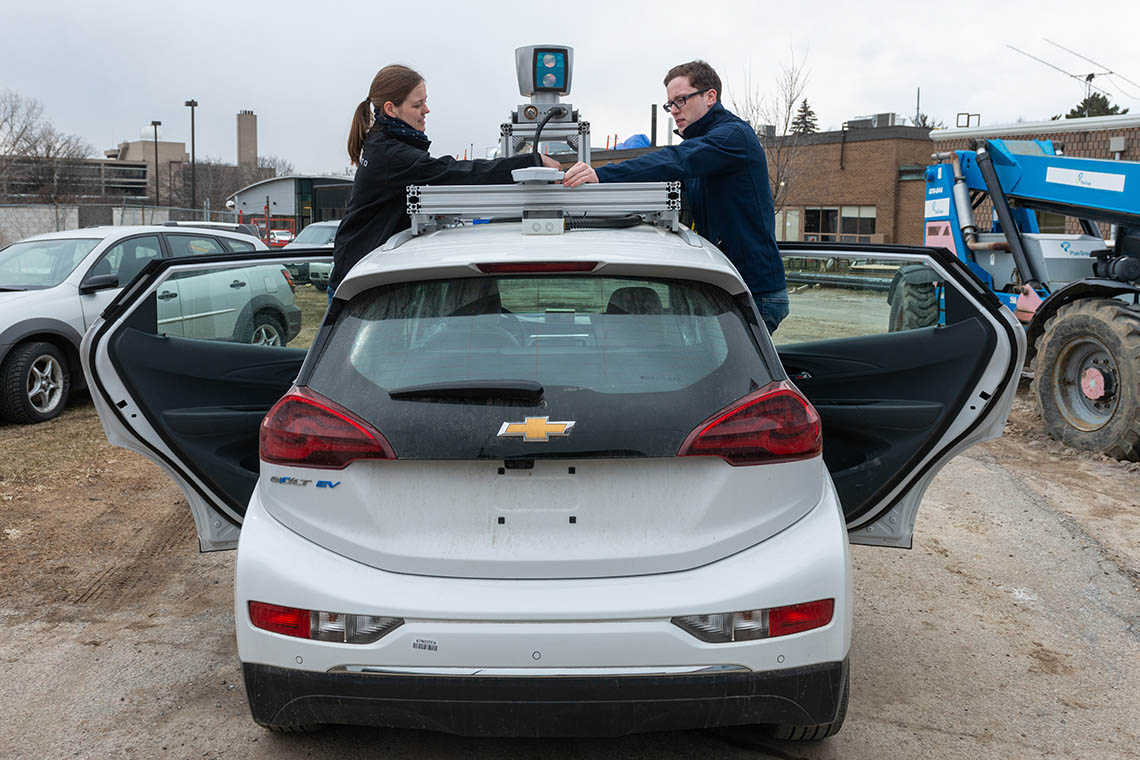 Photo of students working on Zeus, a self-driving vehicle