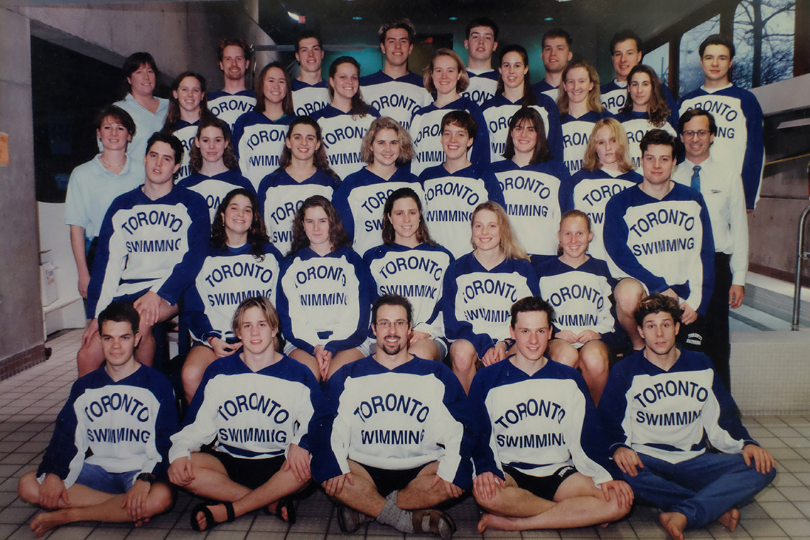 Photo of Catherine McKenna and 1993-1994 swimming teams