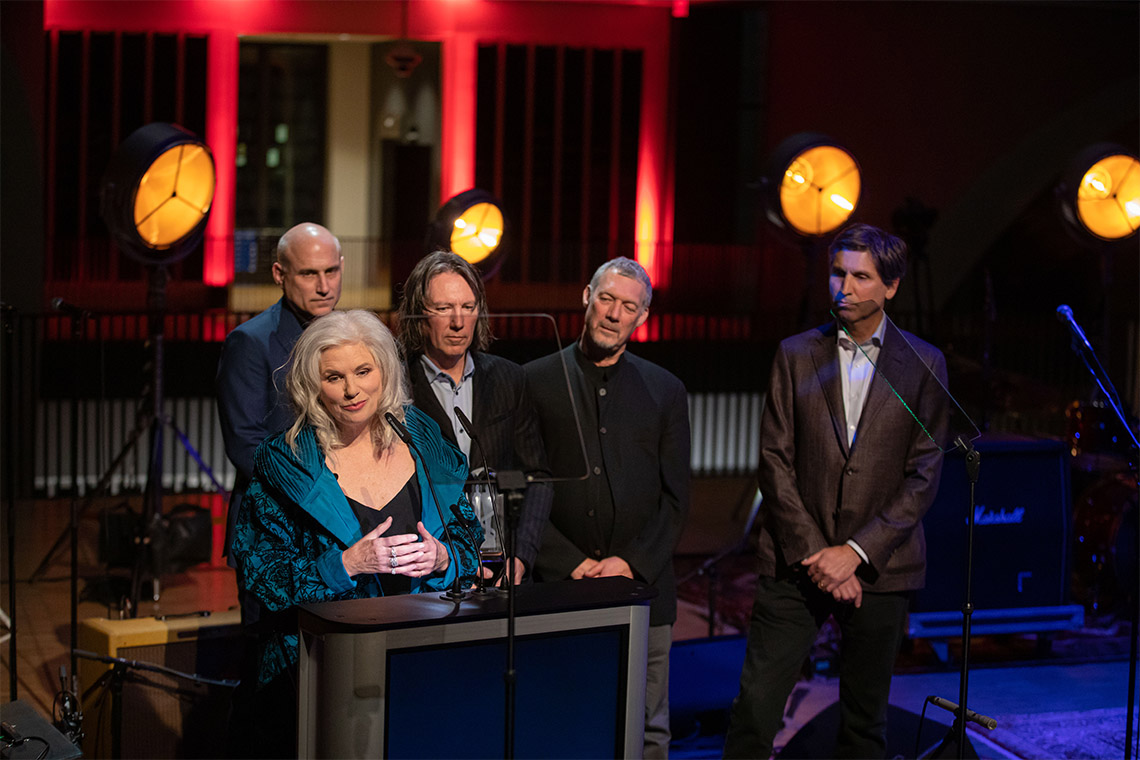 Margot Timmins and the rest of the Cowboy Junkies behind her, gives a speech after being inducted into the hall of fame