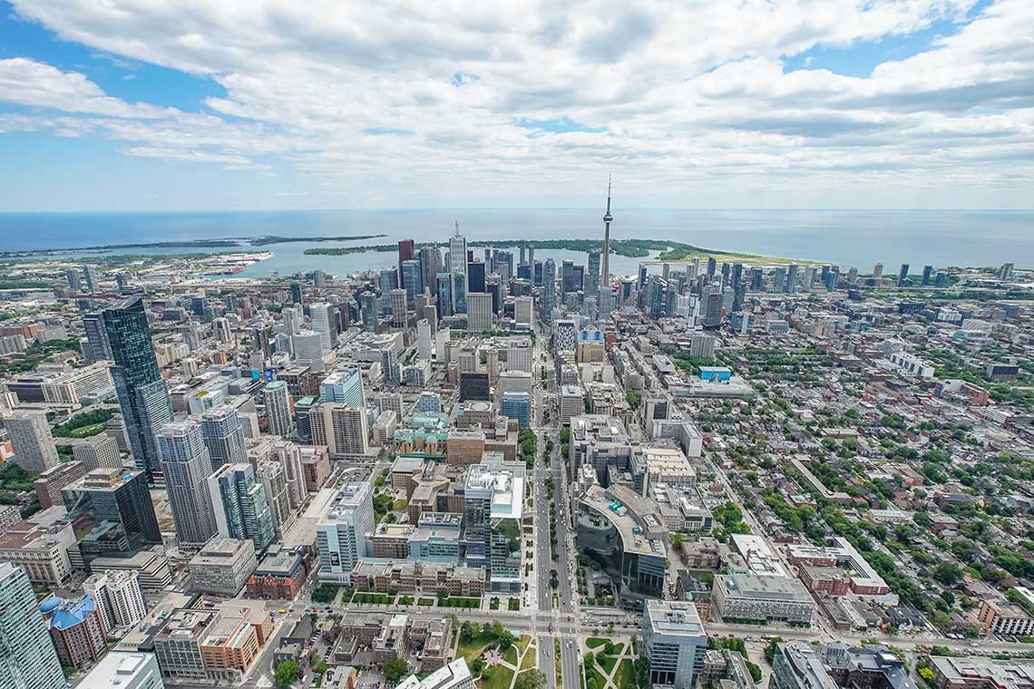 Aerial view of downtown toronto and the CN Tower looking towards the lake