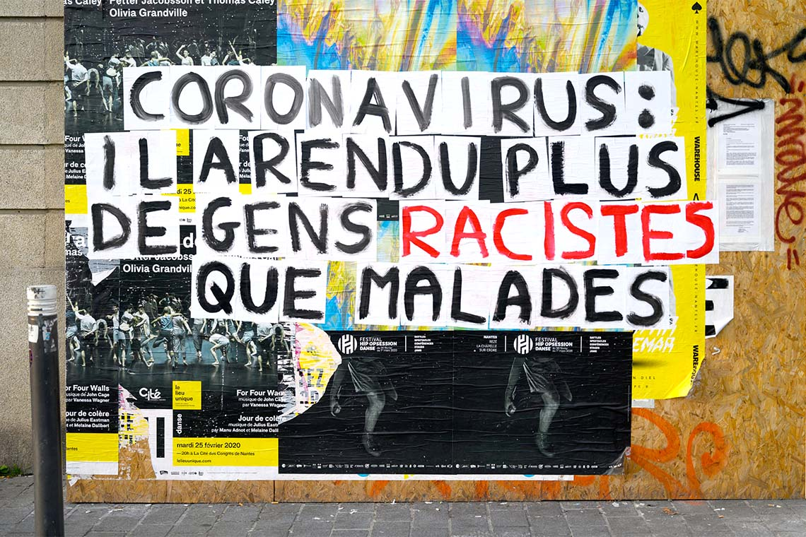 Photo of a sign plastered on a wall in France