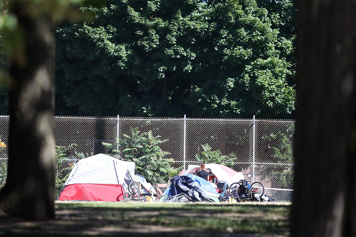 homeless people set up tents in moss park