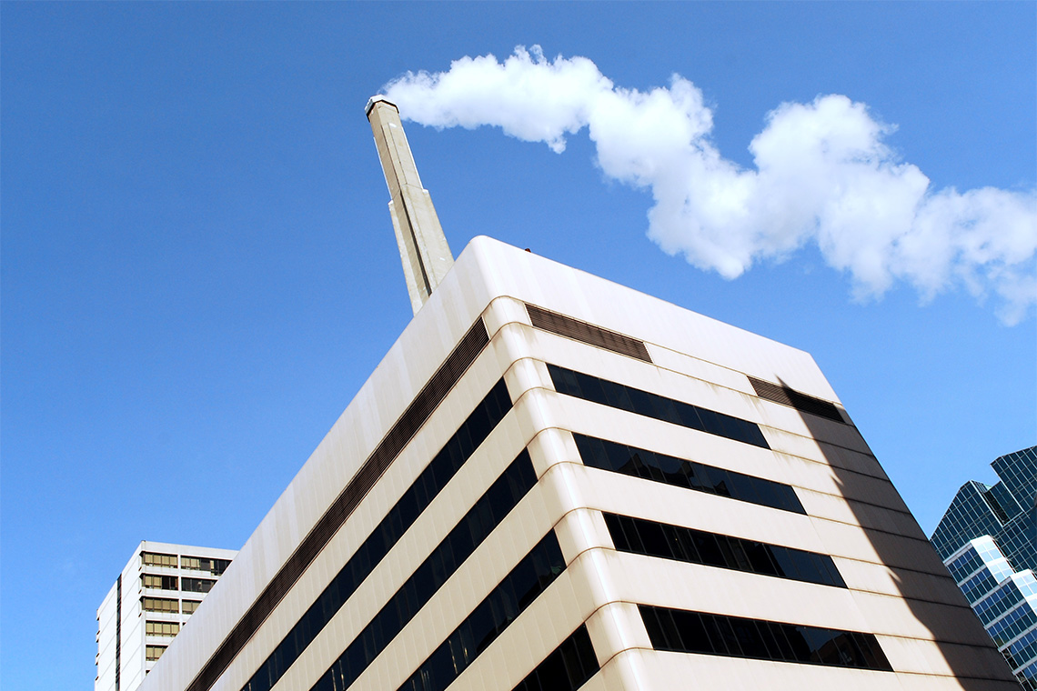 stock image of a smokestack on a hospital building