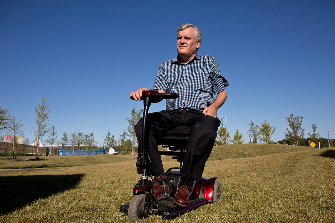David Onley sit atop a mobility device
