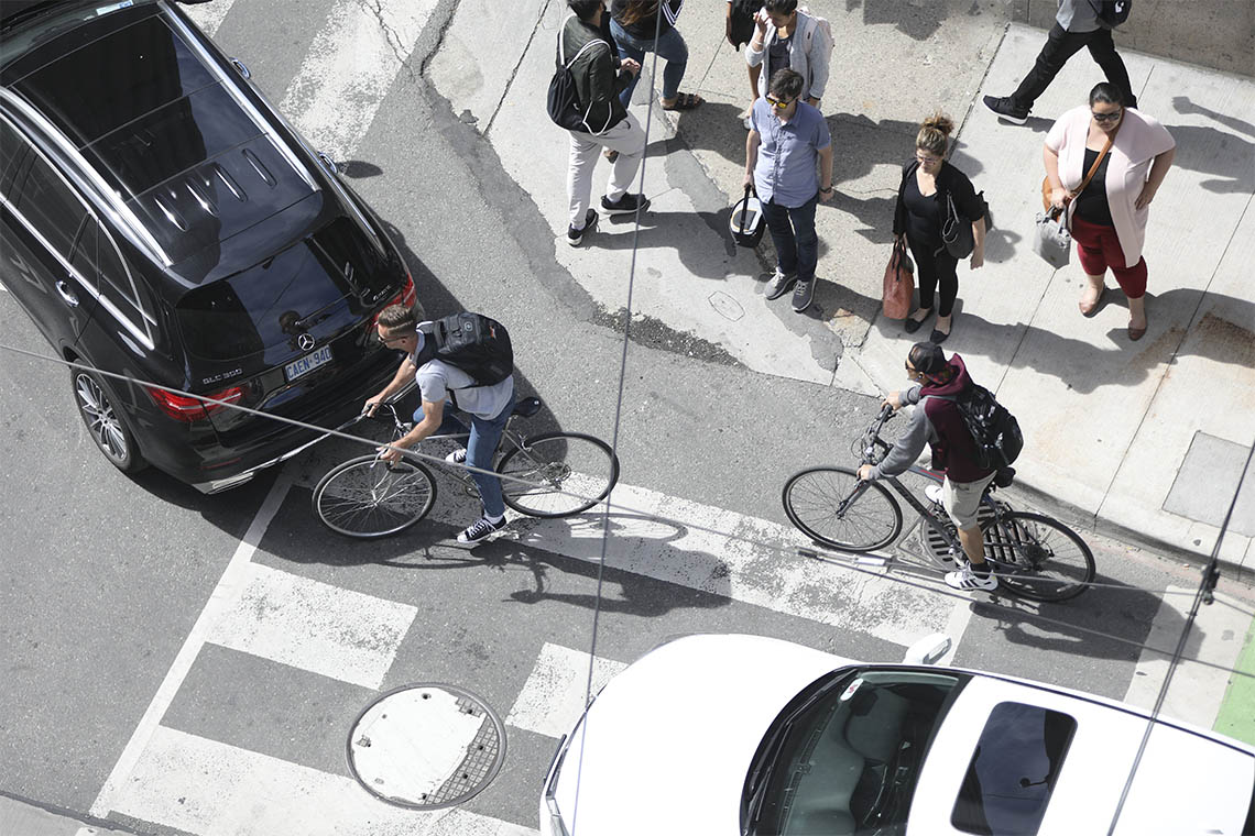 overhead view of toronto cyclists dodging cars at an intersection