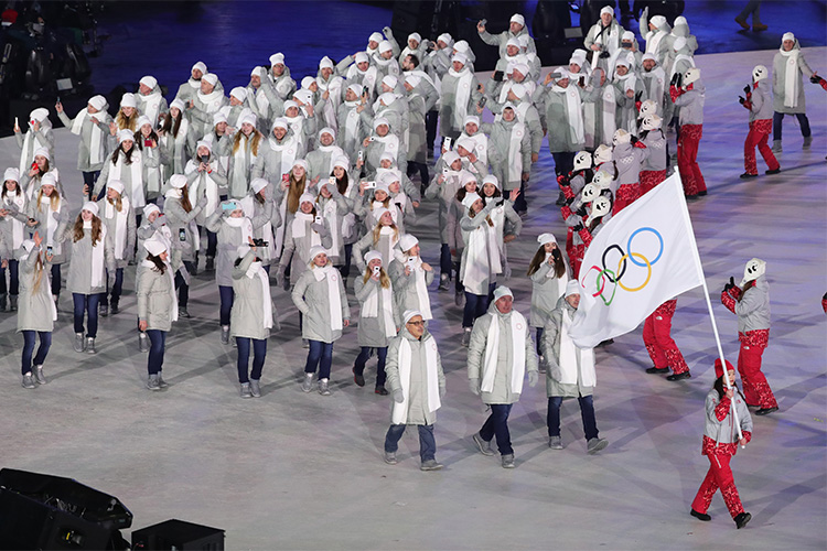 Olympic Atheletes from Russia are led by the Olympic flag during the opening ceremonies of the 2018 pyeongchang olympic winter games