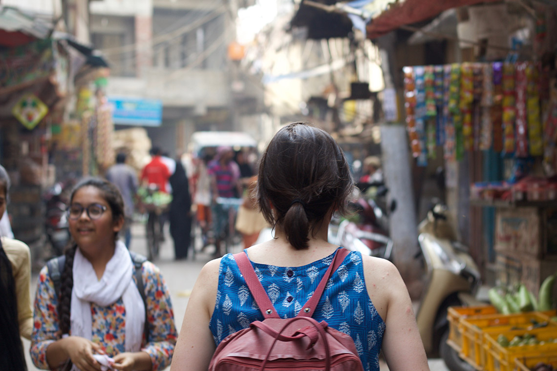 Photo of a student walking in a market
