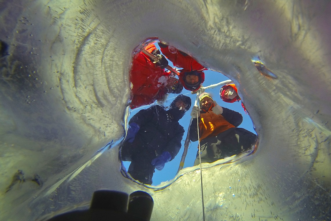 photo of camera being lowered below ice