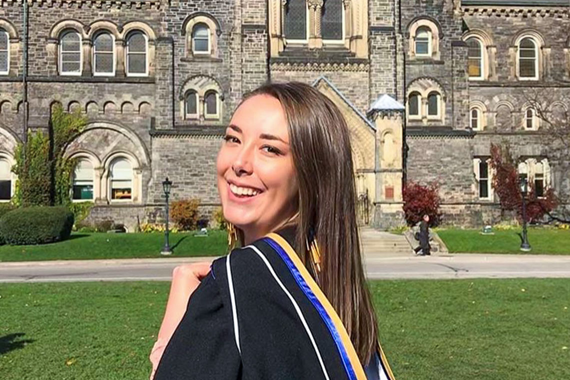 Portrait of Maureen Gustafson in her graduation robes in front of University College