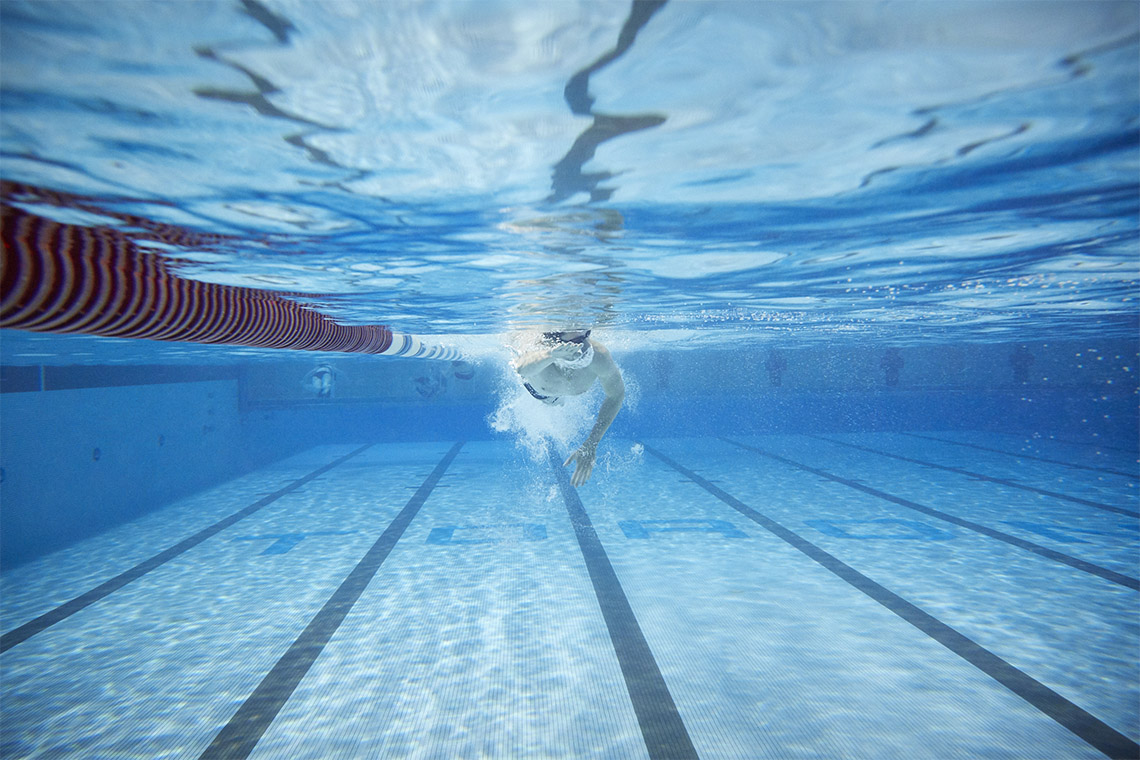 An underwater view of a swimmer in the pool at the University of Toronto's Athletic Centre