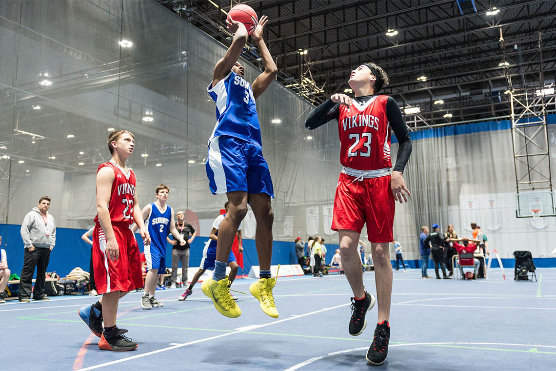 Photo of a Special Olympics athlete shooting a basketball
