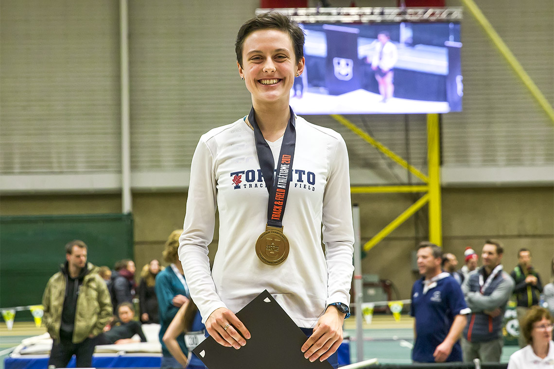 Gabriela DeBues-Stafford stands with a medal draped around her neck