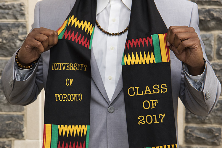 a person at the 2017 black graduation shows of his black graduation scarf