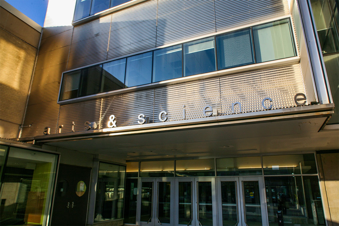 The signage at the main entrance of Sidney Smith Hall reads Arts and Science