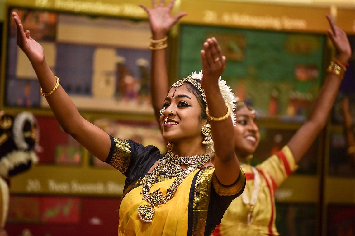two female dancers in traditional dress perform during UTSC's Tamil Heritage Week