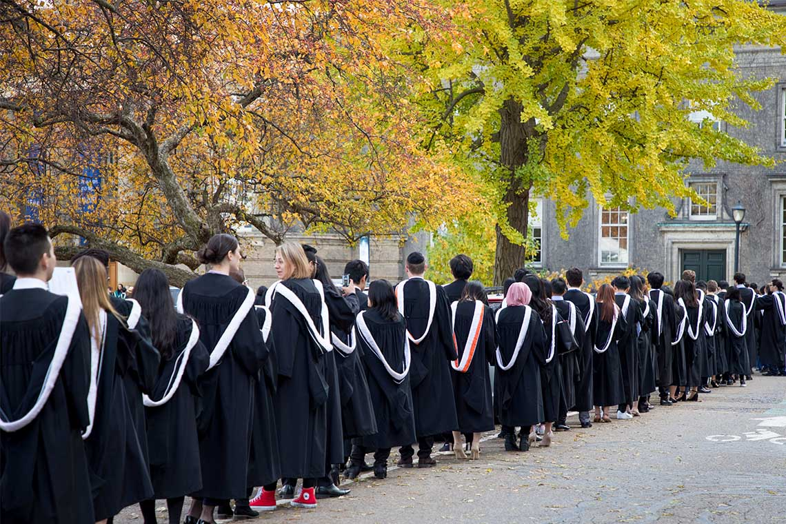 Students line up for fall convocation outside of convocation hall