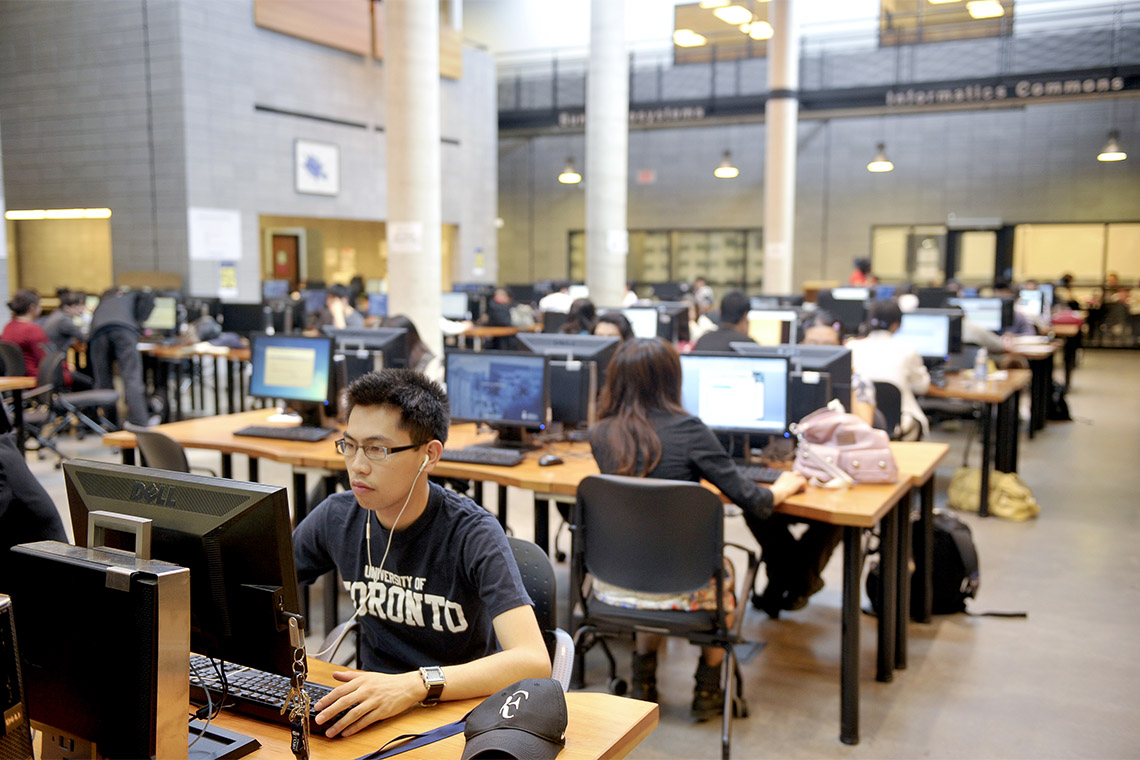 Photo of students at work in library