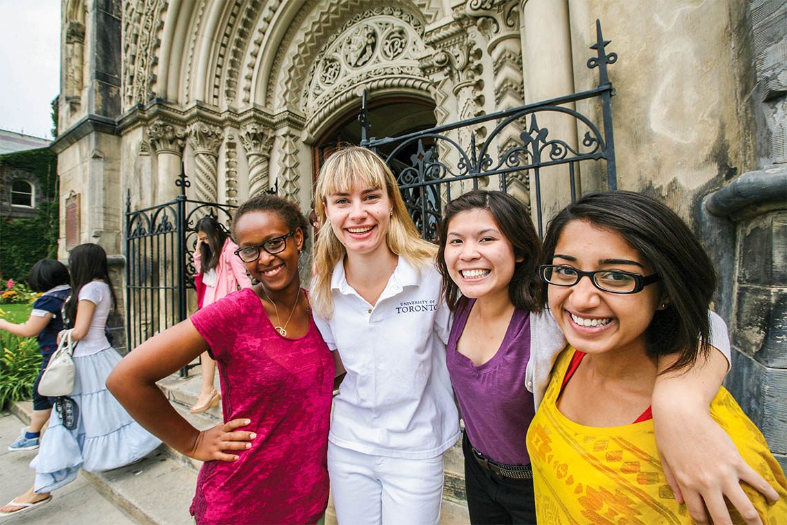 students with a tour guide at university college