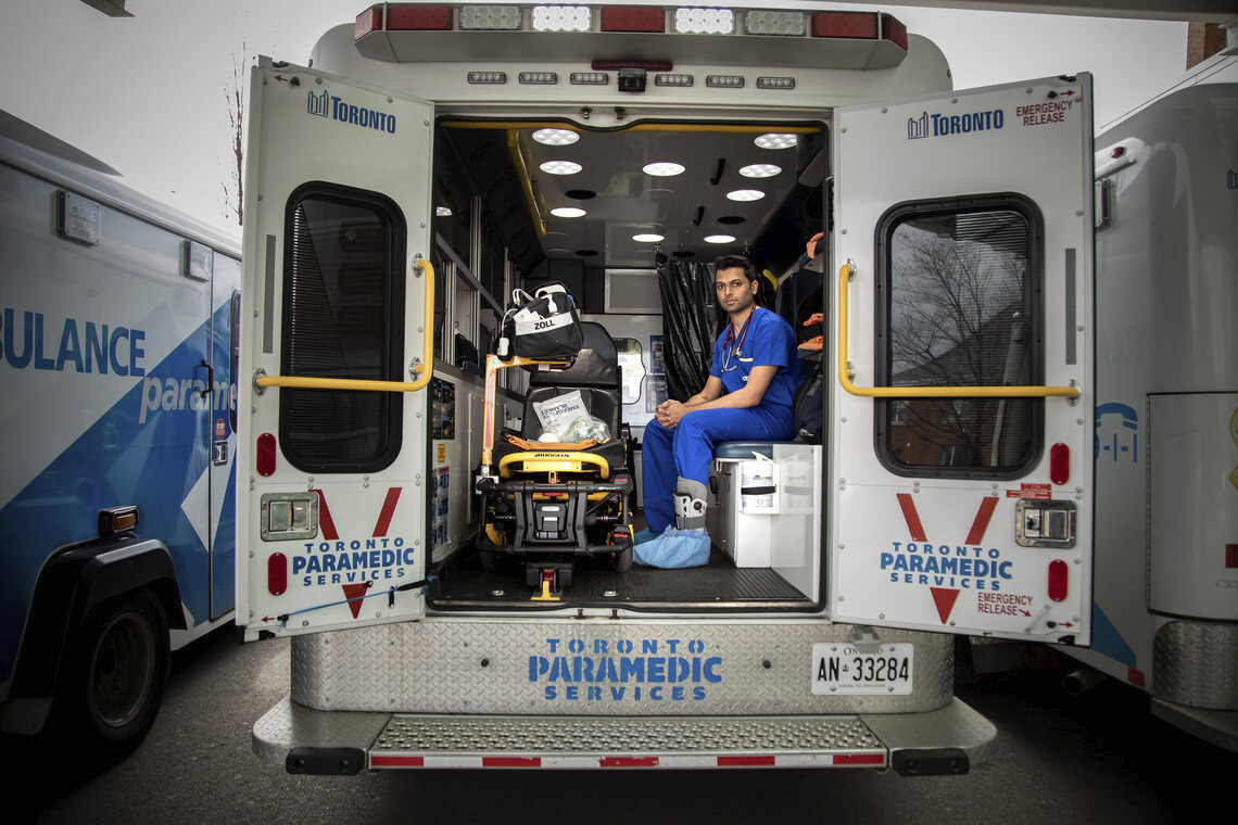 Sameer Masood sits inside an ambulance