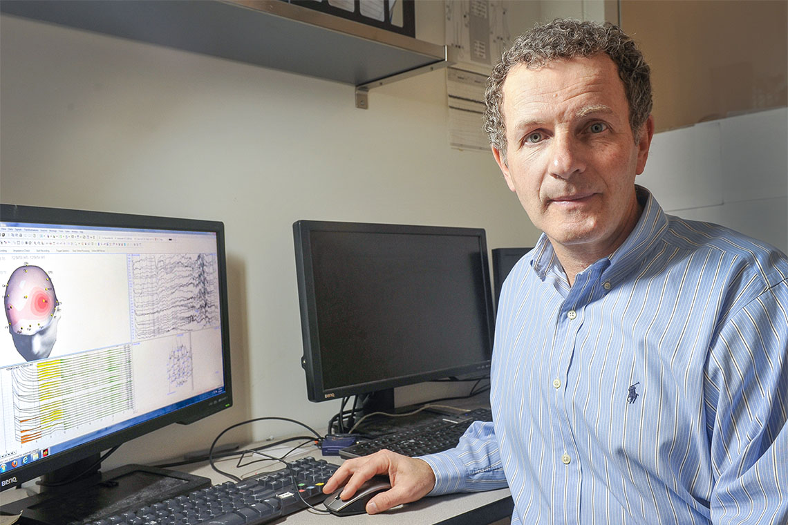 photo of Zindel Segal sitting in front of a computer