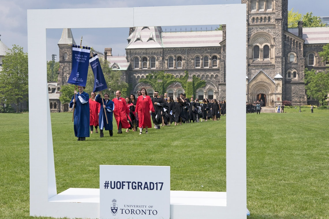 students on campus with the social frame during convocation