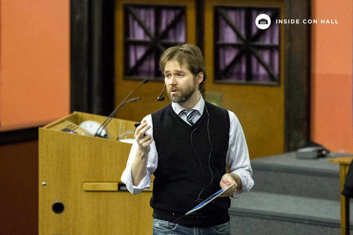 Photo of Christian Caron lecturing in Con Hall