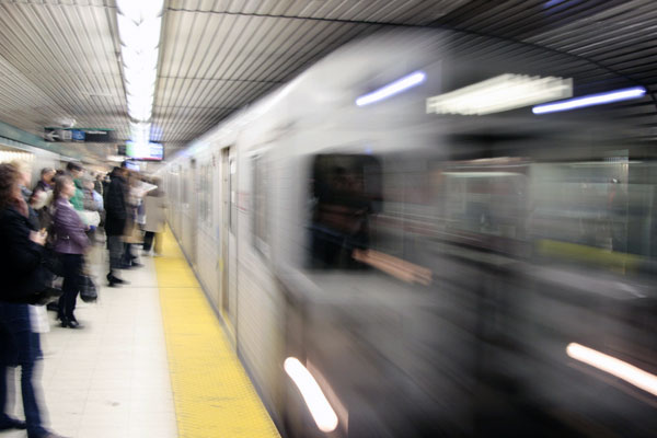 photo of subway train moving so fast it is blurred