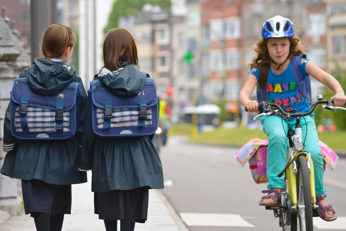 photo from flickr of girls walking and biking