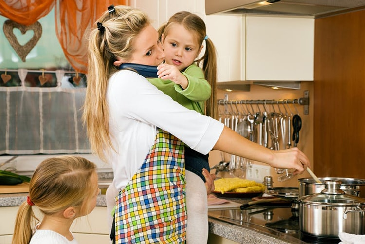 Photo of woman with children cooking