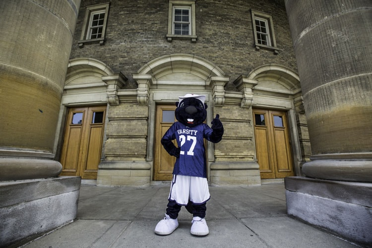 University of Toronto mascot True Blue stands outside Convocation Hall