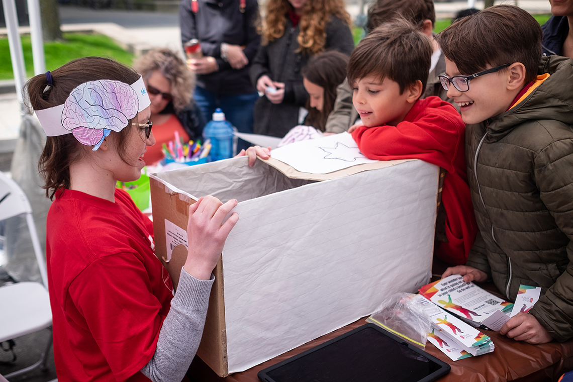 Children participate in a psychology experiment at Science Rendezvous