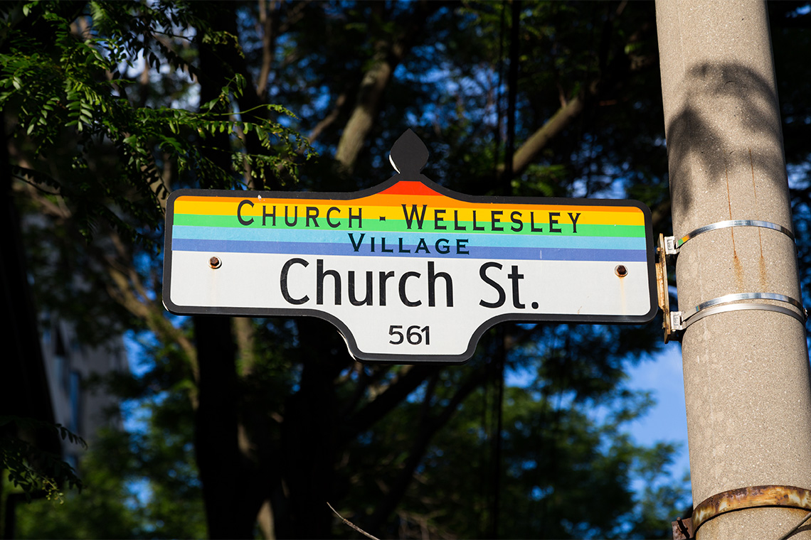 Church st signage in Toronto that has the gay pride flag colours on it