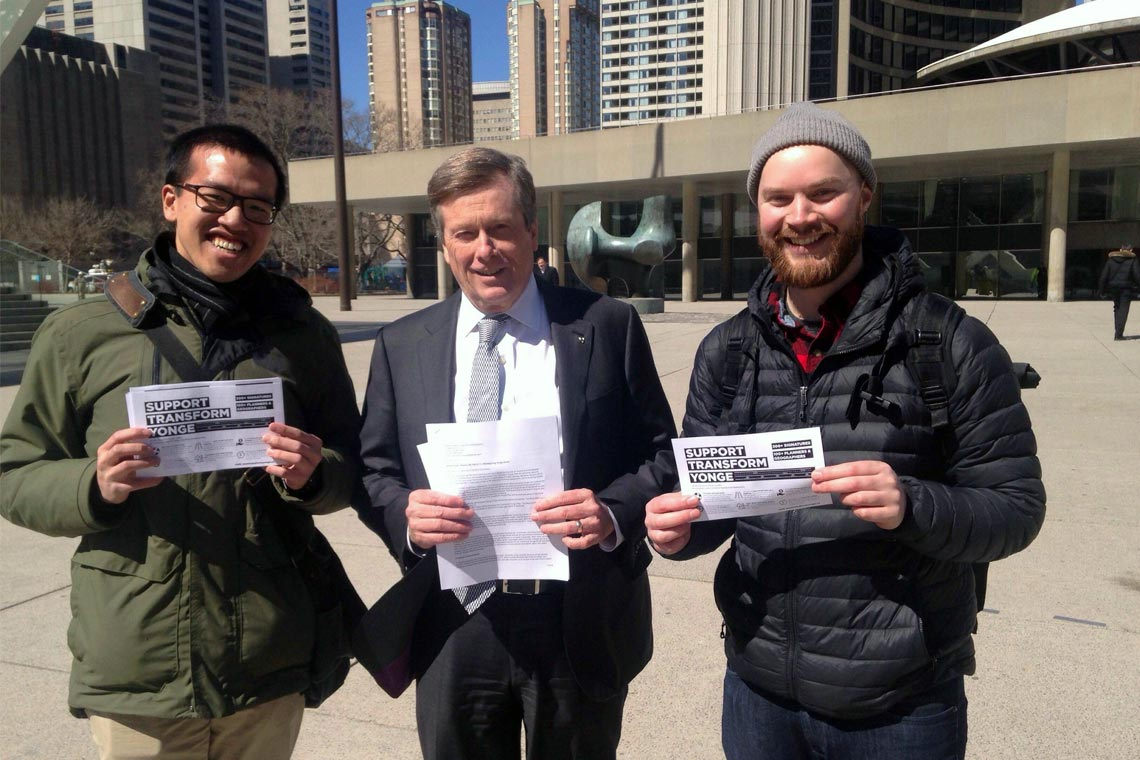 Mayor Tory with planning students holding a petition