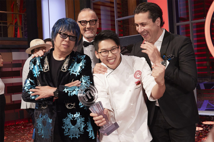Christopher Siu holds the winner's trophy and poses with the masterchef judges