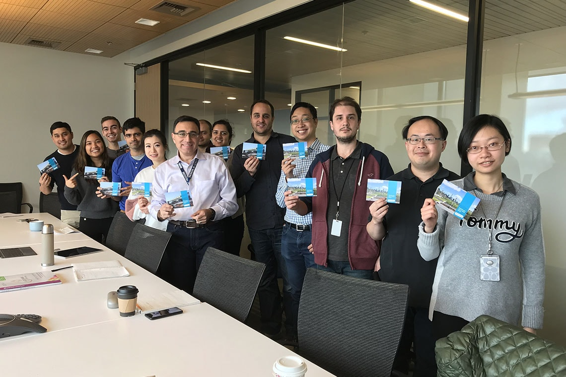 Photo of group with postcards