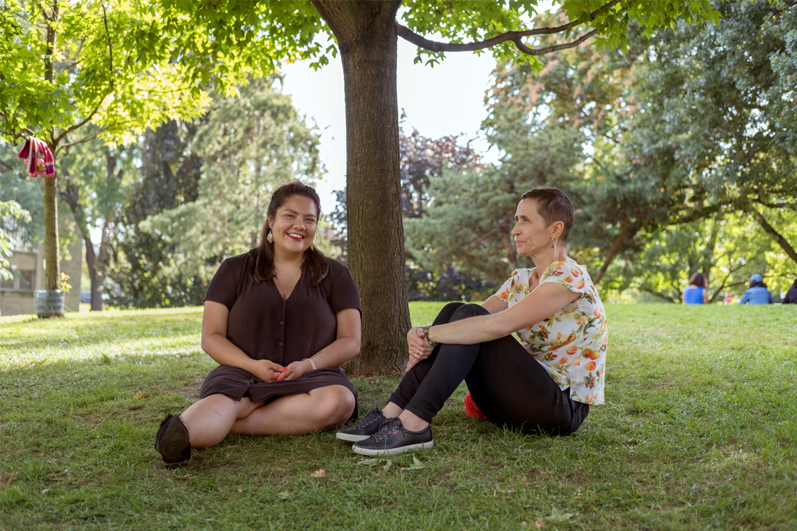 Portrait of Kateri Lucier-Laboucan and Andrea Mantin sitting at the site of the Indigenous Landscape project