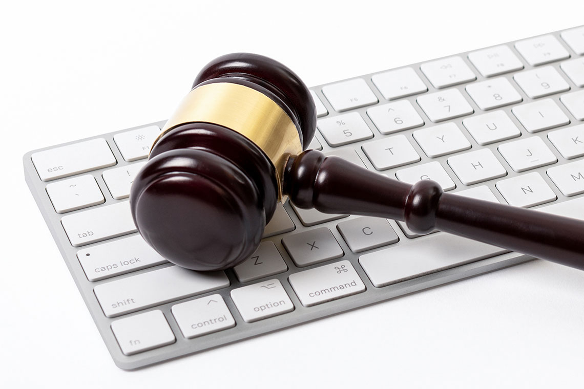 Symbolizing machine learning for lawyers, a judge's gavel rests on a computer keyboard