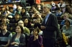 Photo of Reid standing among students lecturing at Con Hall